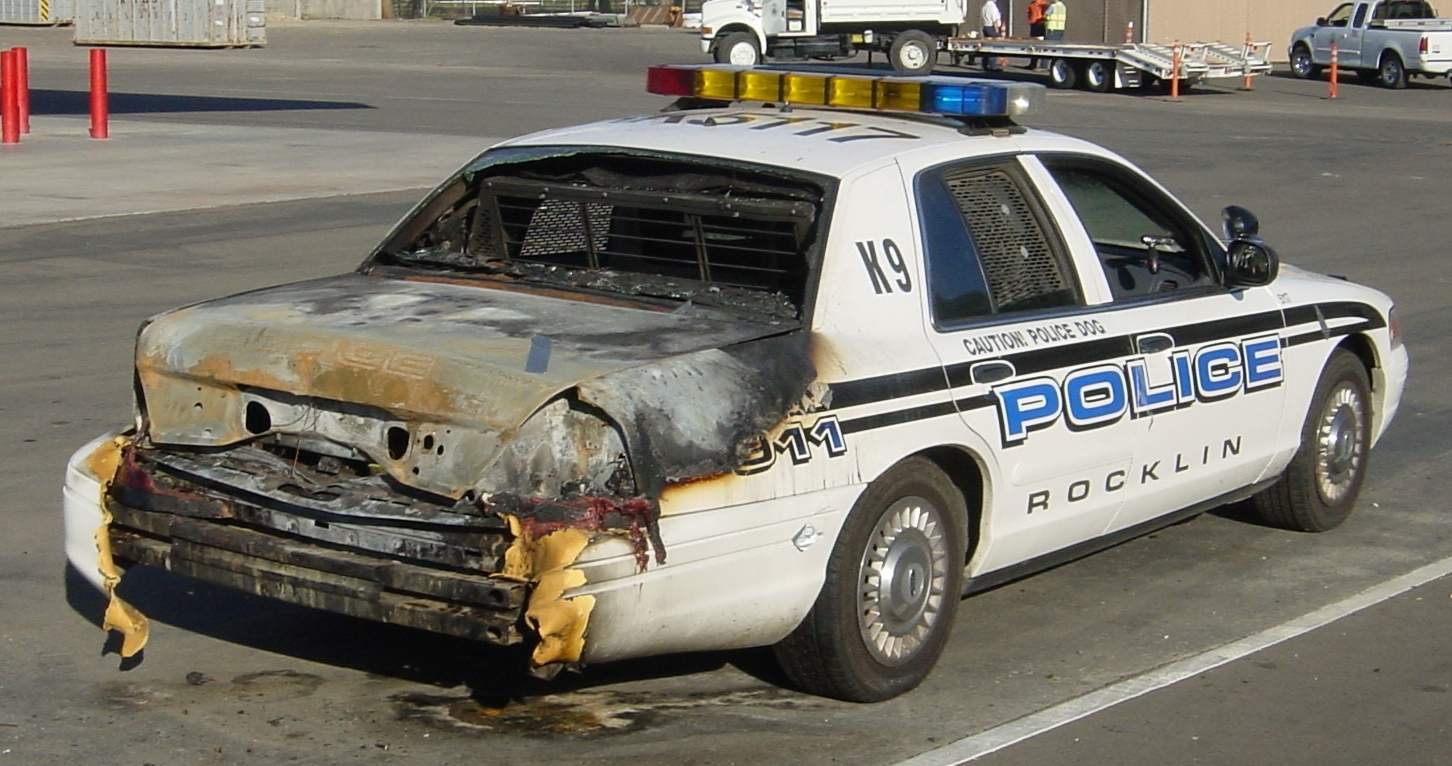 Police car burned from accidental ignition of old-fashioned flare